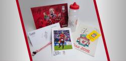 Win a squad signed poster, Keita signed headrest, Van Dijk signed bottle and MORE